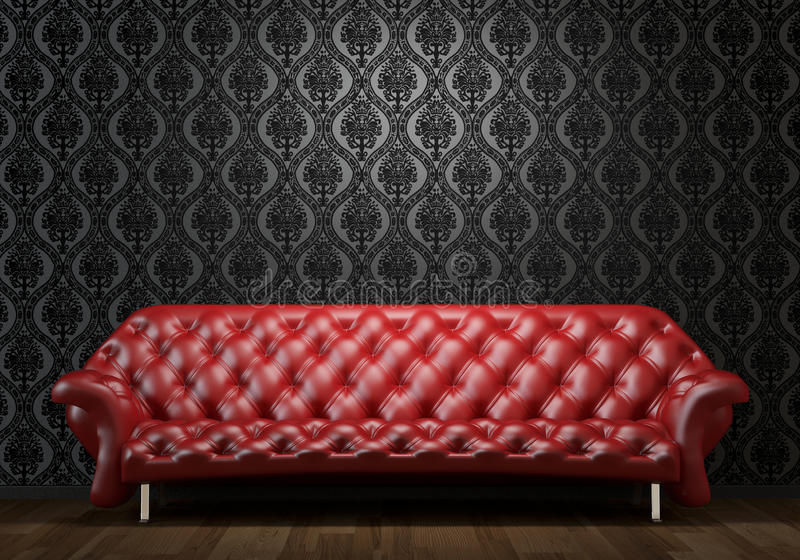Red leather couch on black wall stock image