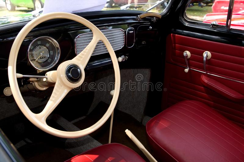 Red Leather Interior of an Antique European Automobile royalty free stock images