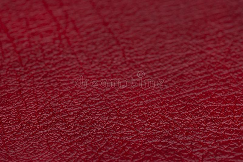 Red leather for manufacturing of shoes, clothes, bags and other fashion accessories, high quality natural seamless material sample. Textured background royalty free stock images