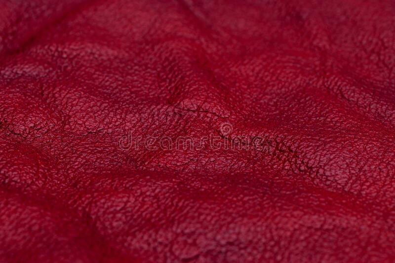 Red leather for manufacturing of shoes royalty free stock photos