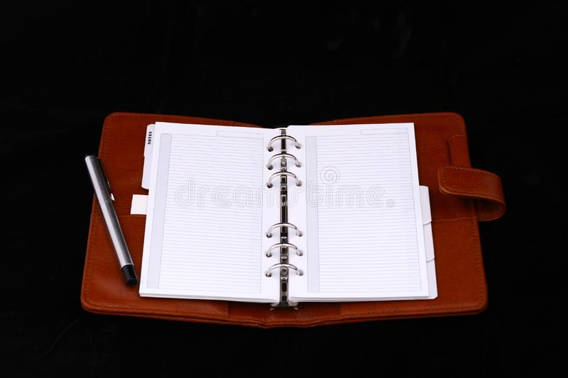 Red leather notebook with silver pen royalty free stock image