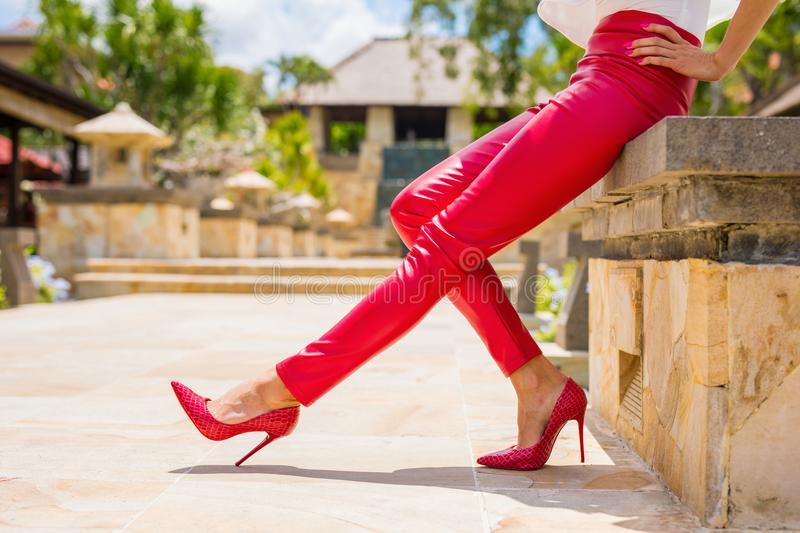 Red leather pants and high heel shoes. Red leather pants and red high heel shoes stock image