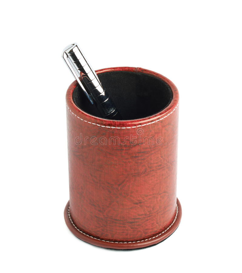 Red leather pen holder cylinder. Box isolated over the white background royalty free stock photo