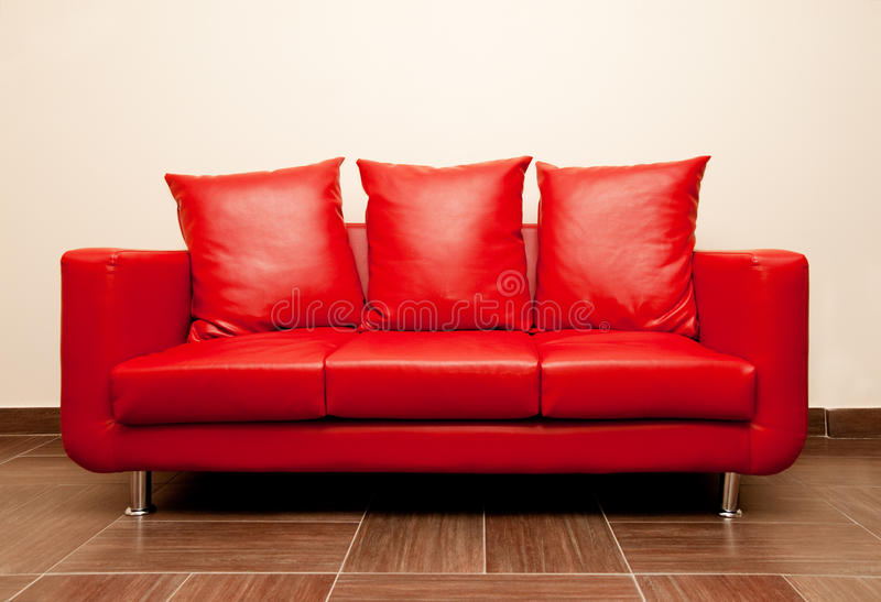 Red leather sofa royalty free stock images
