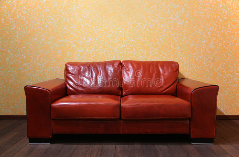 Red leather sofa in room royalty free stock photo