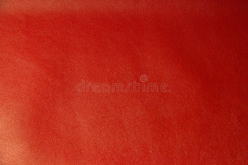 Red leather textural background. Bright red background with skin texture closeup stock images