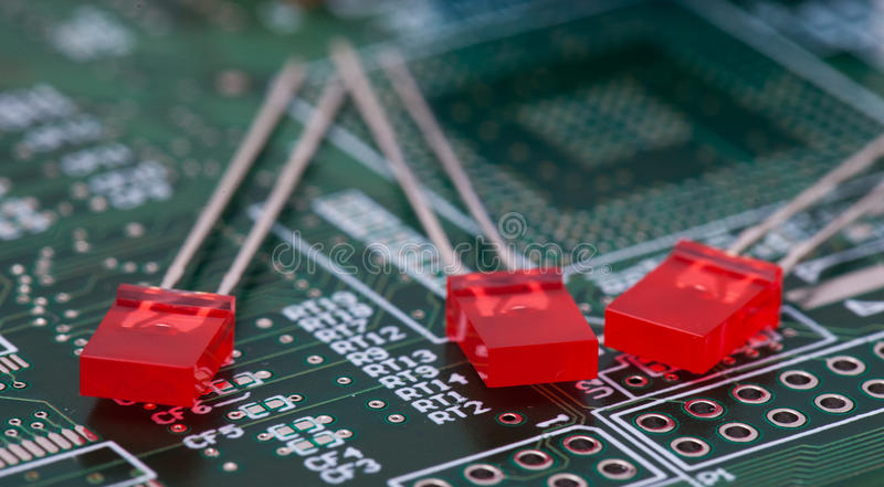 Red LED on green PCB.  royalty free stock photo