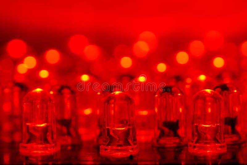 Red LEDs. LED background with dozens transparent red LEDs stock photo
