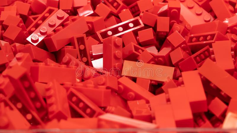 Red Lego blocks, plastic construction toy, manufactured by The Lego Group based in Denmark. London, UK - January 2019: Red Lego blocks, plastic construction toy royalty free stock image