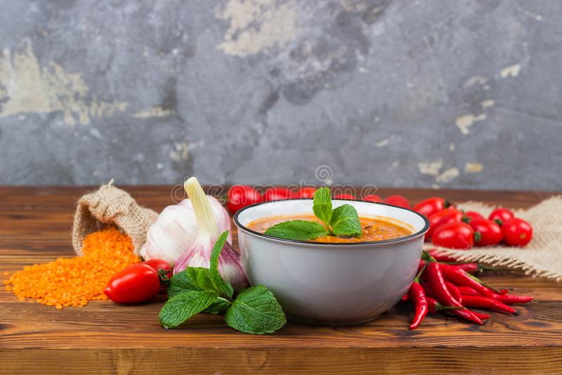 Red lentil soup with ingredients. stock photos