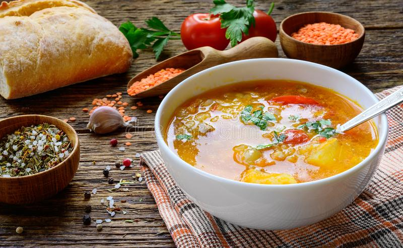 Red lentil soup on the rustic wooden table. royalty free stock image