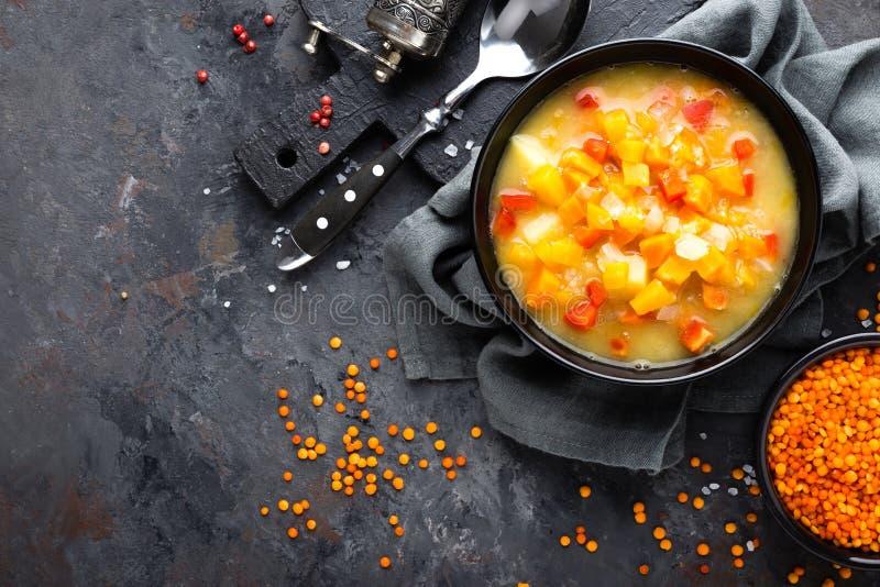 Red lentil soup with vegetables. Vegetarian food. Red lentil soup with vegetables. Healthy vegetarian food royalty free stock image