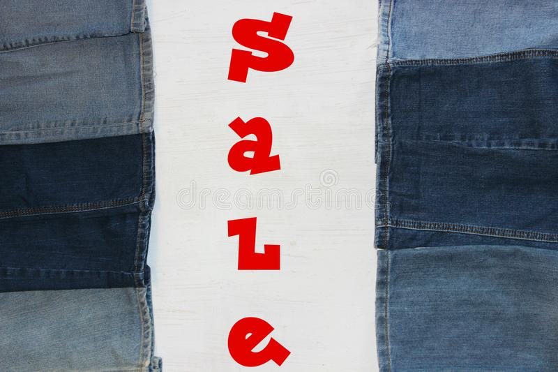 Words sale. Red letters, the word sale on white background, frame textiles, denim fabric stock images