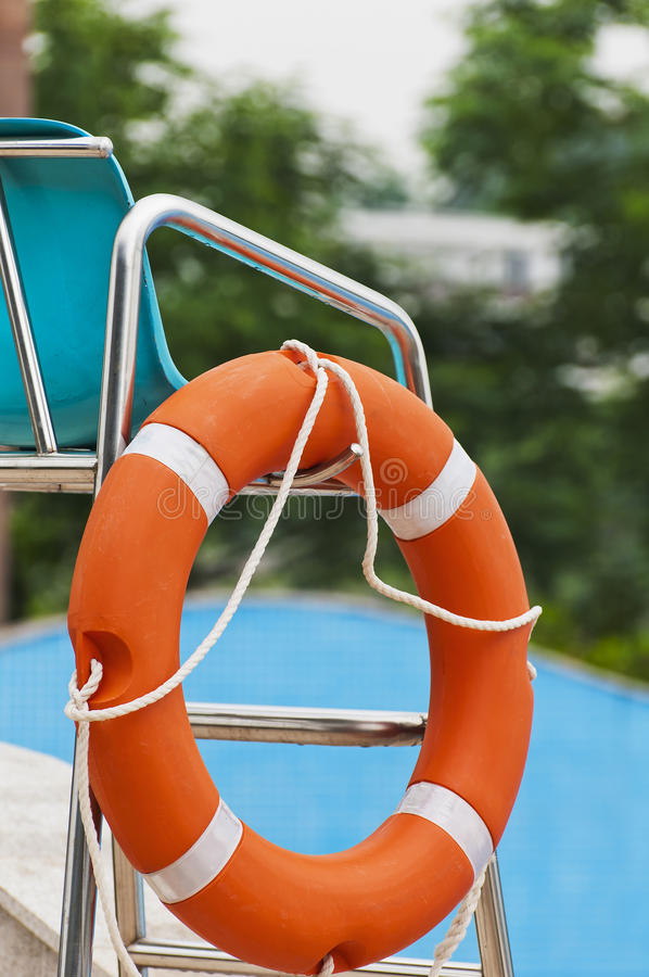 Red life buoy. Hanging on a chair stock image