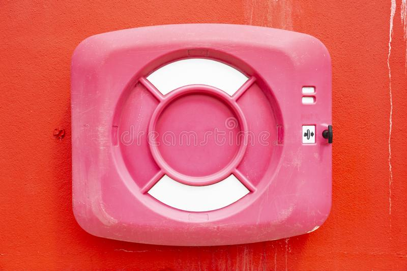 Red life saver buoy ring. Red life buoy ring on the red wall background close up stock photo