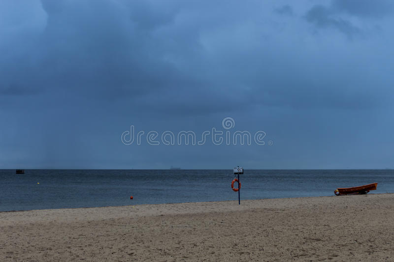 Red lifebuoy on a background of empty sand beach.  royalty free stock photo