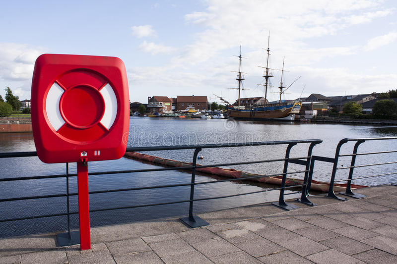 Download Red Lifebuoy In Front Of The River. Stock Image - Image: 32315379