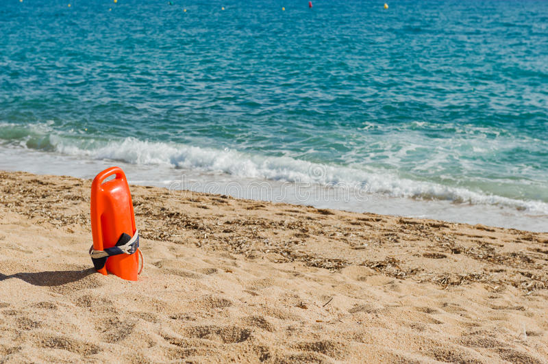 Red lifeguard buoy. In sand on a beach royalty free stock images