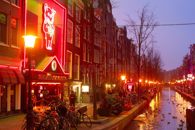 Red Light, Amsterdam. AMSTERDAM, NETHERLANDS - MARCH 10, 2013: Red-light district in Amsterdam. There are about three hundred cabins rented by prostitutes in the stock image