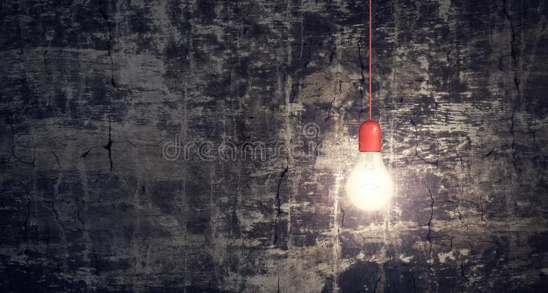 Red light bulb on dark grunge background idea concept royalty free stock photos