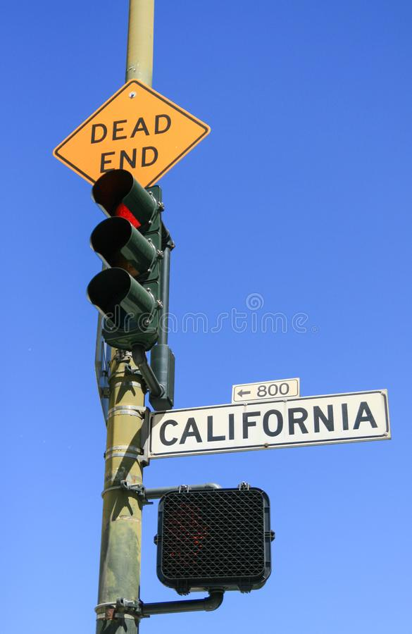 Red light at Dead End and California street signs. Red light at Dead End and California street traffic signs stock photos