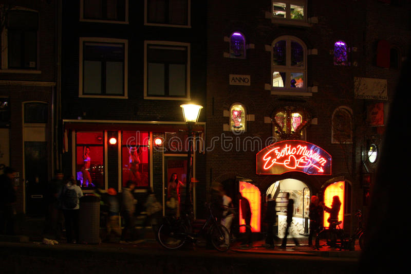 Red light district in Amsterdam. Amsterdams prostitution district with cabins and erotic museum at night royalty free stock photography
