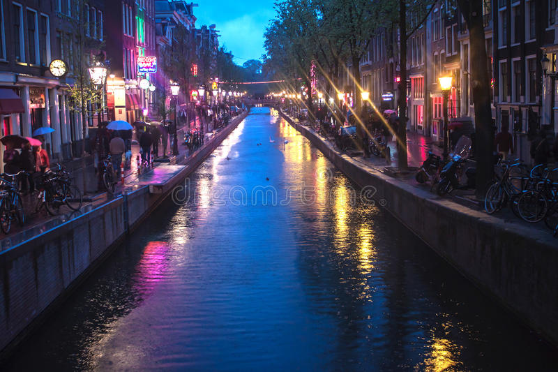 Red Light District. AMSTERDAM - MAY 11: Red Light District on May 11, 2013 in Amsterdam, Netherlands. There are over 500 windows in the city and about 1000 royalty free stock photo