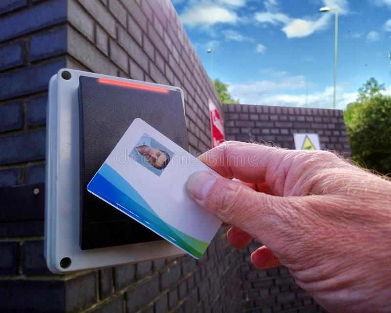Red light on an electronic card reader, showing a man being refused access to a secure location royalty free stock photo
