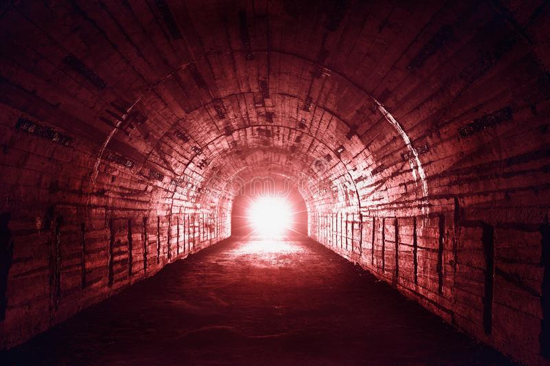 Red light in end of abandoned underground military corridor or tunnel, scary horror or thriller and fear atmosphere. Concept royalty free stock images