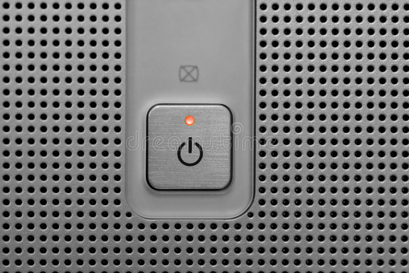 Red light power button in electronic device stock photo