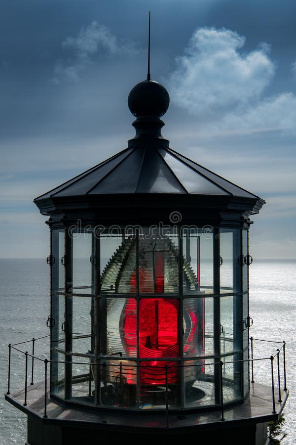 Red light reflecting through the fresnel lens in the cupola of a lighthouse stock photos