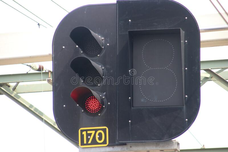 Red light sign above railroad track for stop train at railway station Den Haag Mariahoeve in the Netherlands royalty free stock photo