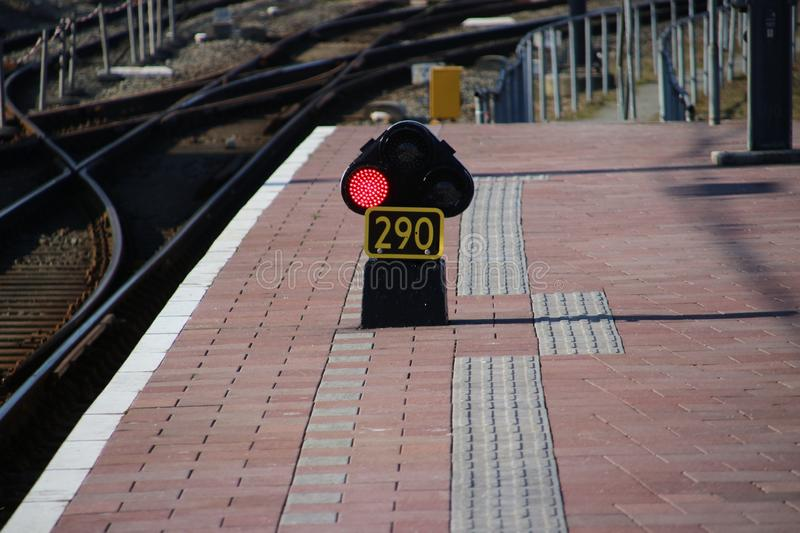 Red light sign 290 on the railroad platform at Rotterdam Central station in the Netherlands. stock photography