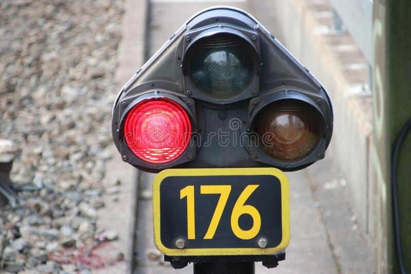 Red light sign between railroad track for stop train at railway station Den Haag Mariahoeve in the Netherlands royalty free stock photos