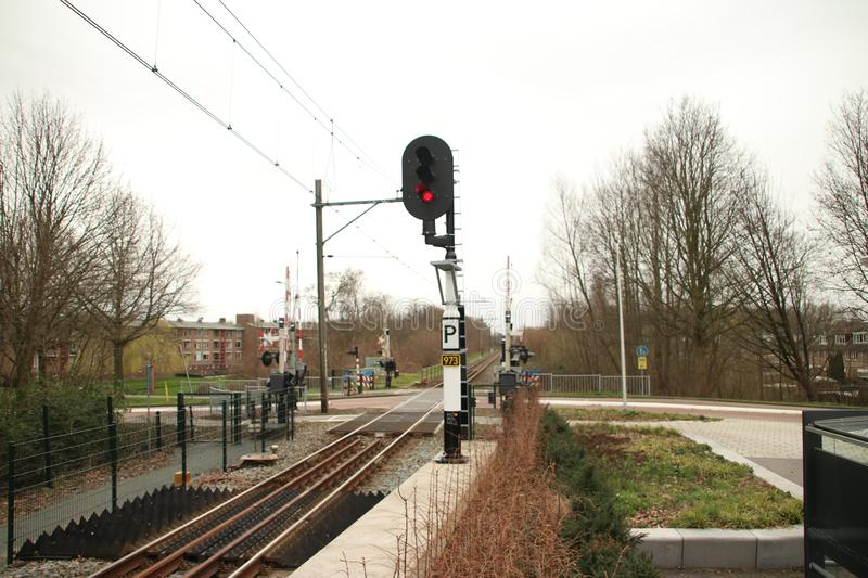 Red light sign at station Boskoop Snijdelwijk for R-NET train heading Gouda. stock photos