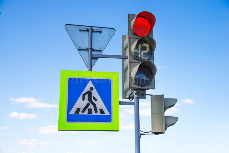 Red light traffic light signal with road signs royalty free stock photography
