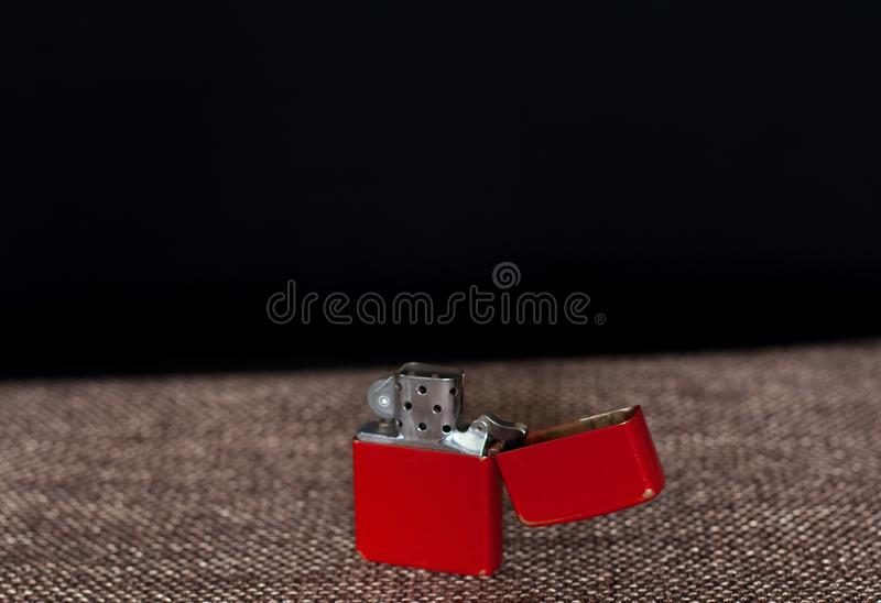 Red lighter on a black background stock photography
