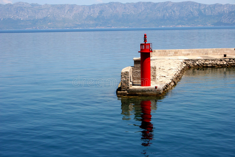 Red Lighthouse. Modern lighthouse on Croatia coastline royalty free stock photography