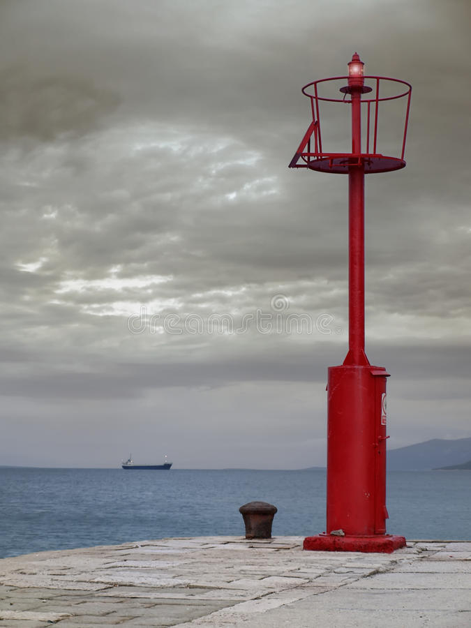 Download Red lighthouse stock image. Image of vessel, gray, clouds - 14826829