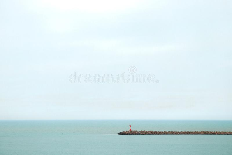 Red lighthouse on horizon background royalty free stock images