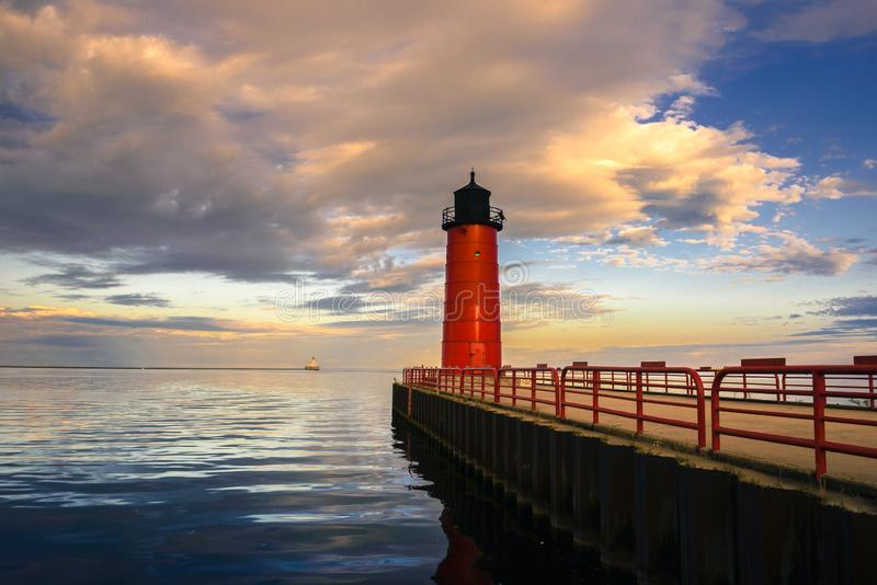 Red Lighthouse on Lake Michigan in Milwaukee, Wisconsin. At sunrise with beautiful cloudy skies royalty free stock photo