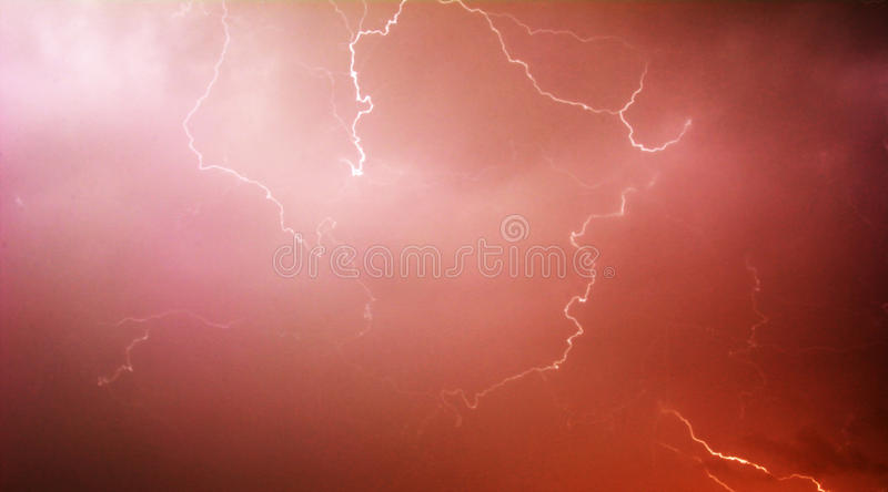 Red lightning. Lightning strike with post production royalty free stock images
