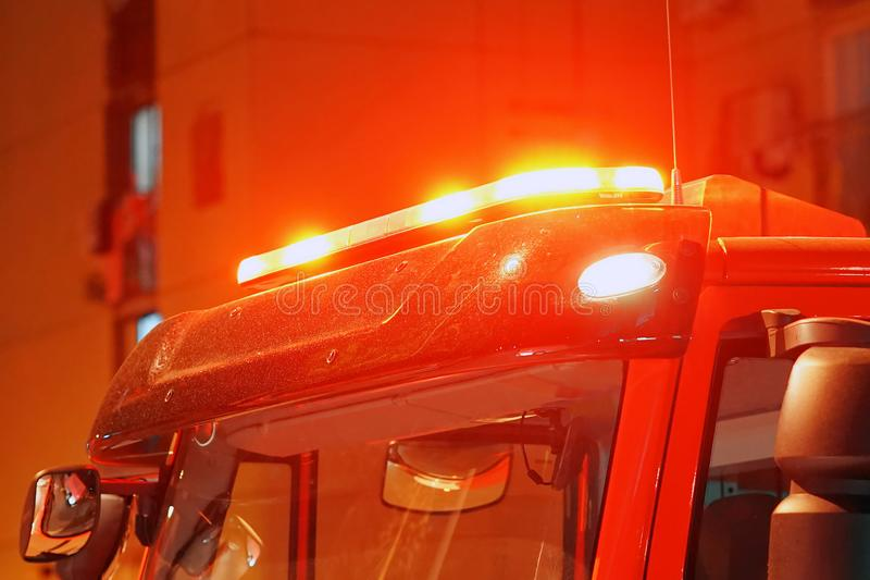 Red lights on top of Fire engine car. Red lights of a fire engine. Night time. Fire engine. Extinguishing the fire. Close-up of the red lights on top of a fire royalty free stock photos