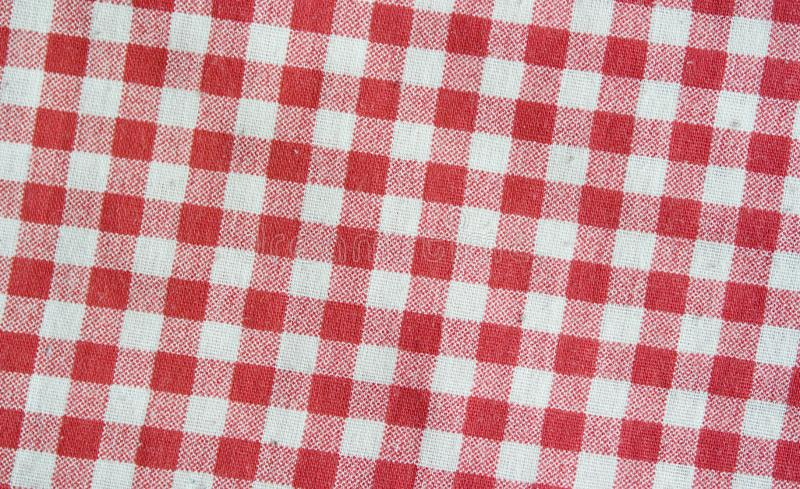 Red linen checkered tablecloth. Red and white texture. royalty free stock photography