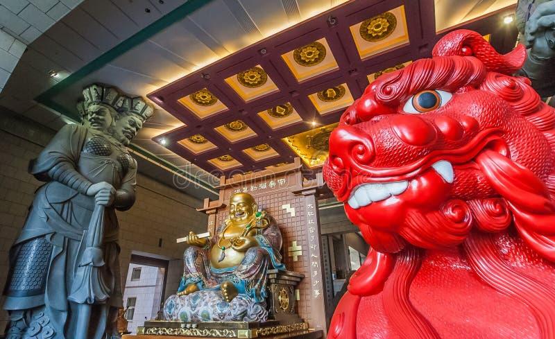 Red lion and chinese Buddha stock photo
