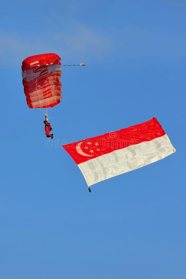 Red Lions parachuting with Singapore flag royalty free stock photo