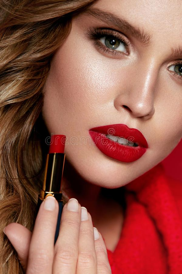 Free Red Lips. Beautiful Woman With Beauty Makeup Holding Lipstick. Royalty Free Stock Photography - 113126917