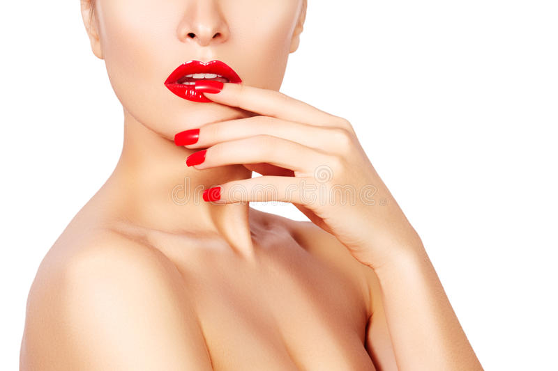 Red lips and bright manicured nails. open mouth. Beautiful manicure and makeup. Celebrate make up and clean skin. Kiss stock image