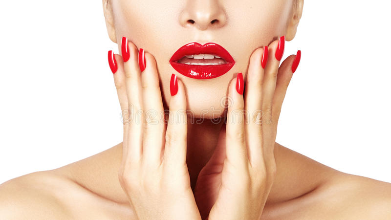Red lips and bright manicured nails. open mouth. Beautiful manicure and makeup. Celebrate make up and clean skin. Kiss