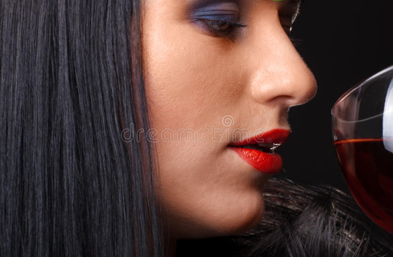 Red lips and glass of wine stock photo